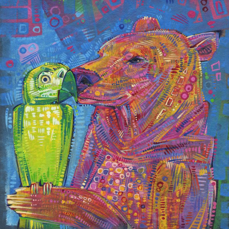 bear kissing a parrot