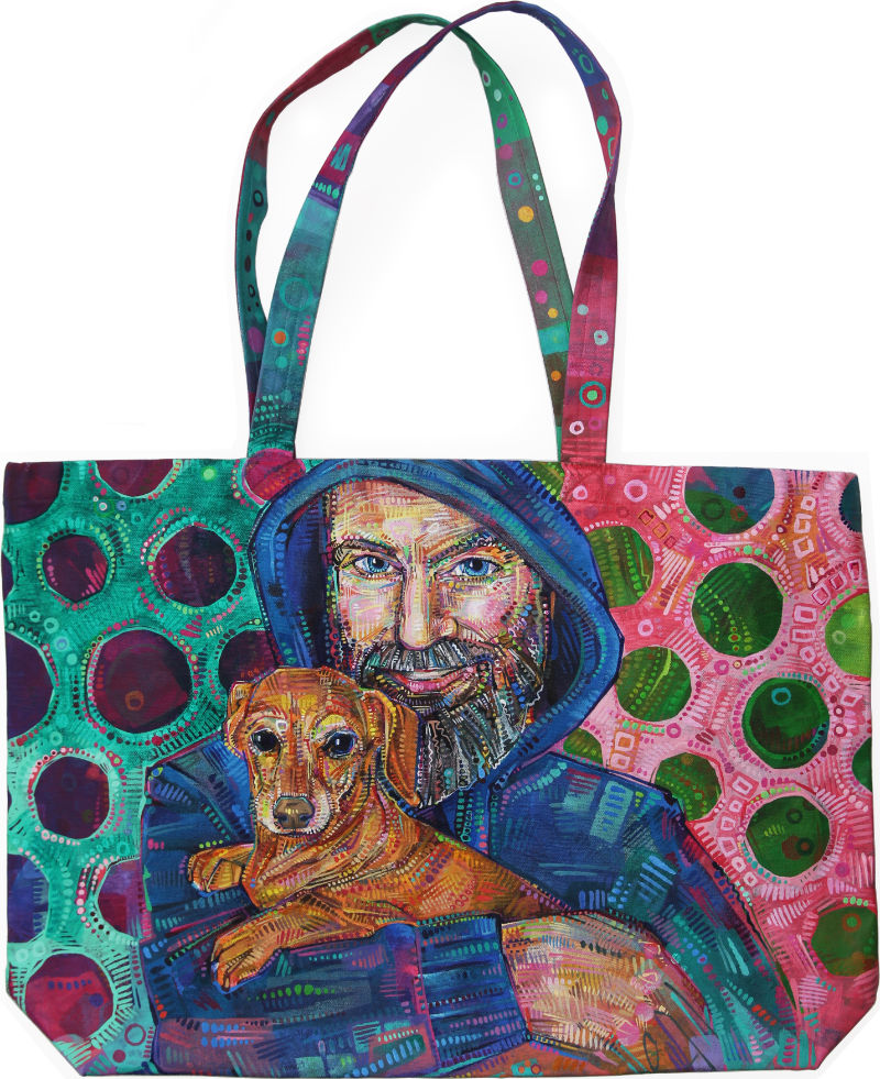 painted portrait on a canvas bag