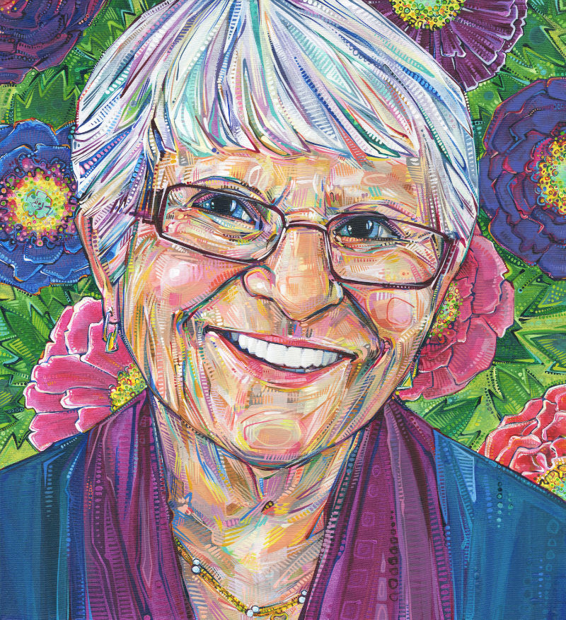 bust style portrait of a 90 year old white woman smiling and wearing glasses with peony flowers in the background